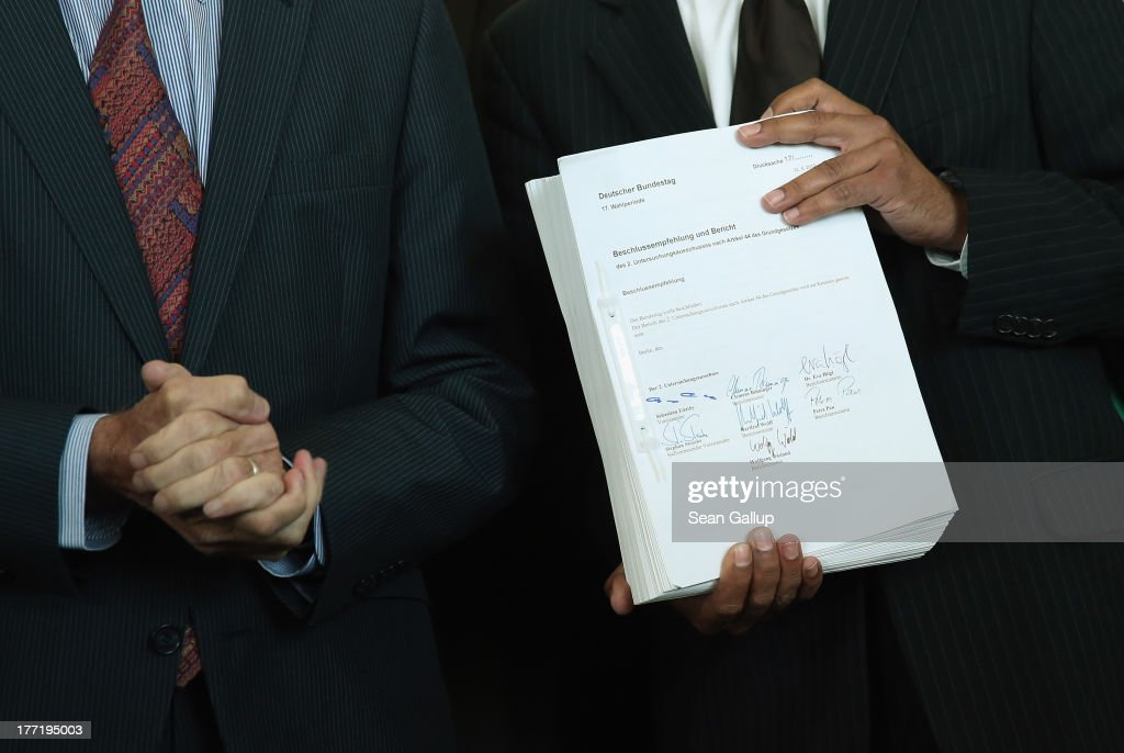 Sebstian Edathy, chairman of the Bundestag commission investigating the NSU murder series, holds the 1,300-page report prepared by the commission while speaking to the media as he stands next to <a gi-track='captionPersonalityLinkClicked' href=/galleries/search?phrase=Norbert+Lammert&family=editorial&specificpeople=575522 ng-click='$event.stopPropagation()'>Norbert Lammert</a> (L), President of the Bundestag, on August 22, 2013 in Berlin, Germany. The report details conclusions and recommendations by the commission into the conduct of police, intelligence and other law enforcement agencies regardig the NSU neo-Nazi murder series, which, due to the failure of police investigating the crimes, has become one of the biggest scandals in post-World War II German law enforcement history.