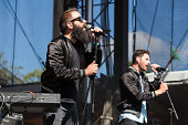 Sebu Simonian and Ryan Merchant of Capital Cities performs at the Bumbershoot Music and Arts Festival on September 1 2014 in Seattle Washington