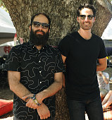 Sebu Simonian and Ryan Merchant of Capital Cities pose at the Austin City Limits Music Festival at Zilker Park on October 3 2014 in Austin Texas