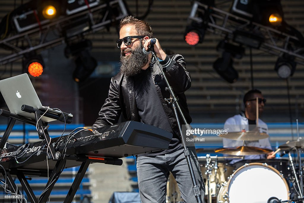Sebu Simonian of Capital Cities performs at the Bumbershoot Music and Arts Festival on September 1 2014 in Seattle Washington
