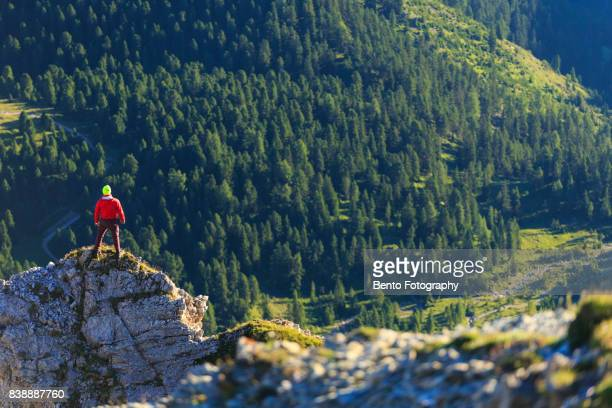 15/07/2017 Secede, Dolomite, Italy : A man with red shirt stand on the top of the rock in Seceda