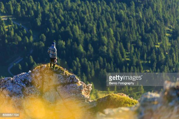 15/07/2017 Secede, Dolomite, Italy : Small man stand on the top of the rock in Seceda