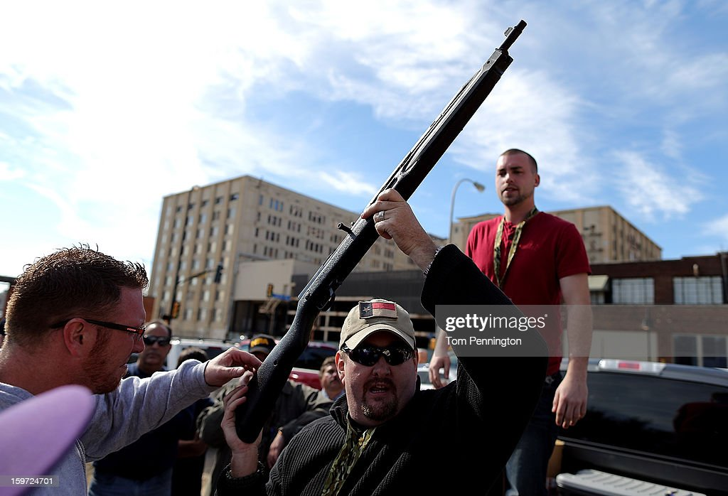 Second Amendment supporter and gun enthusiast Derek Ringley displays an unloaded rifle that was being sold in an impromptu auction across the street from a gun buy back program at the First Presbyterian Church of Dallas on January 19, 2013 in Dallas, Texas. U.S. President Barack Obama recently unveiled a package of gun control proposals that include universal background checks and bans on assault weapons and high-capacity magazines.