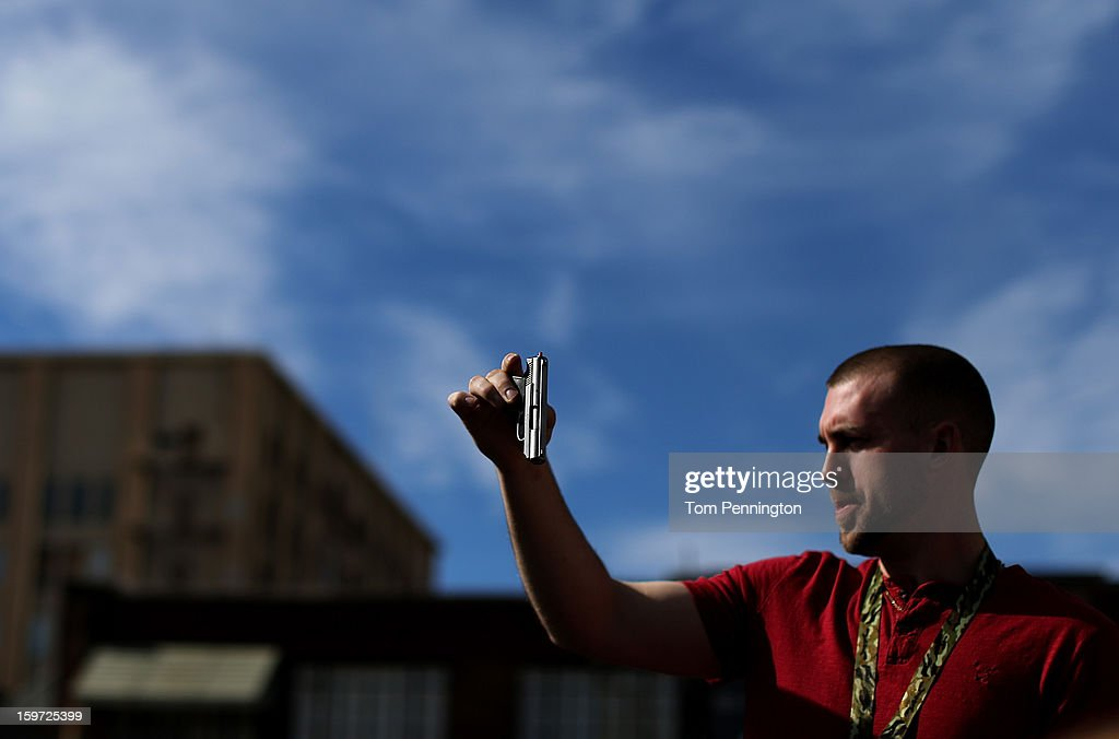 Second Amendment supporter and gun enthusiast Shade Haddox displays an unloaded pistol that was being sold in an impromptu auction across the street from a gun buy back program at the First Presbyterian Church of Dallas on January 19, 2013 in Dallas, Texas. U.S. President Barack Obama recently unveiled a package of gun control proposals that include universal background checks and bans on assault weapons and high-capacity magazines.