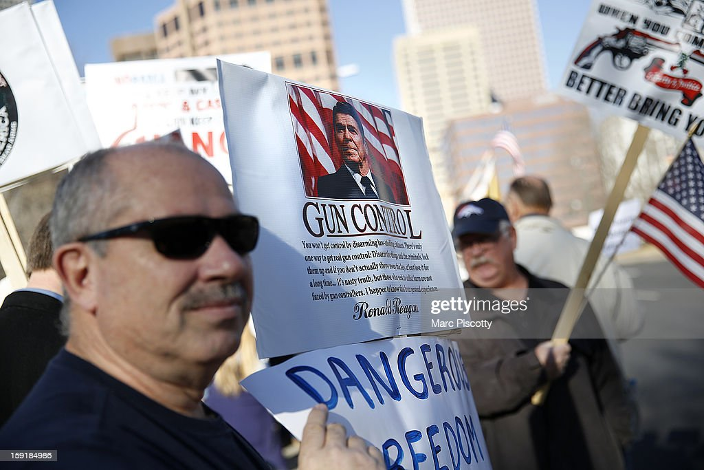 Second Amendment supporter Paul Padovano (L) of Centennial, Colorado gathers with other activists in support for gun ownership on January 9, 2013 at the Colorado State Capitol in Denver, Colorado. Lawmakers are calling for tougher gun legislation after recent mass shootings at an Aurora, Colorado movie theater and at Sandy Hook Elementary School in Newtown, Connecticut.