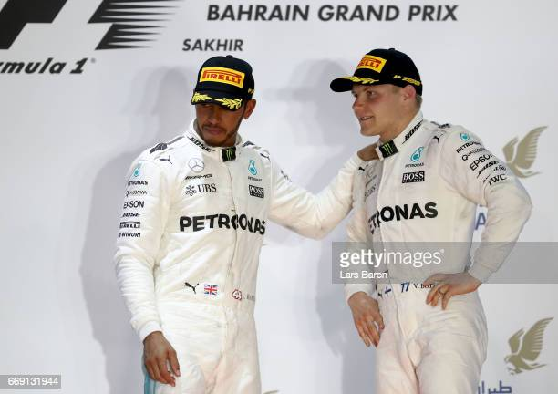 Second and third placed drivers Lewis Hamilton of Great Britain and Mercedes GP and Valtteri Bottas of Finland and Mercedes GP on the podium during...