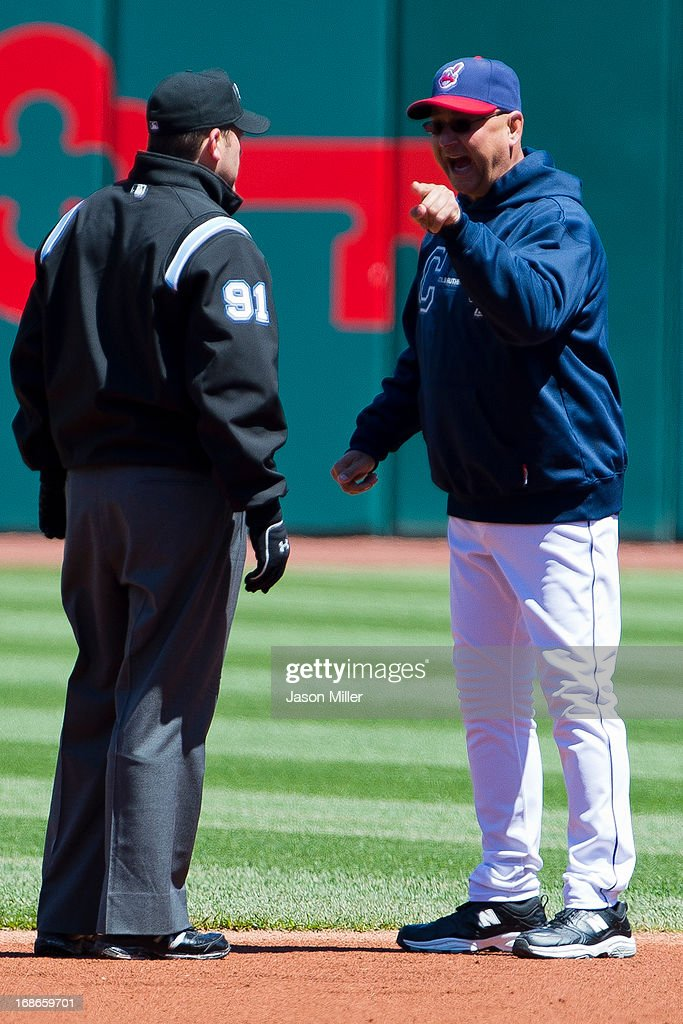 Second base umpire Brian Knight #91 listens to manager <a gi-track='captionPersonalityLinkClicked' href=/galleries/search?phrase=Terry+Francona&family=editorial&specificpeople=171936 ng-click='$event.stopPropagation()'>Terry Francona</a> #17 of the Cleveland Indians argue a call during the first inning against the New York Yankees during the first game of a doubleheader at Progressive Field on May 13, 2013 in Cleveland, Ohio.