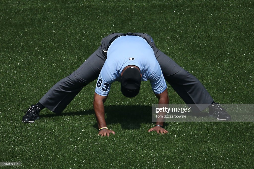 Second base umpire Laz Diaz stretches before the start of the Toronto Blue Jays MLB game against the Tampa Bay Rays on July 18 2015 at Rogers Centre...