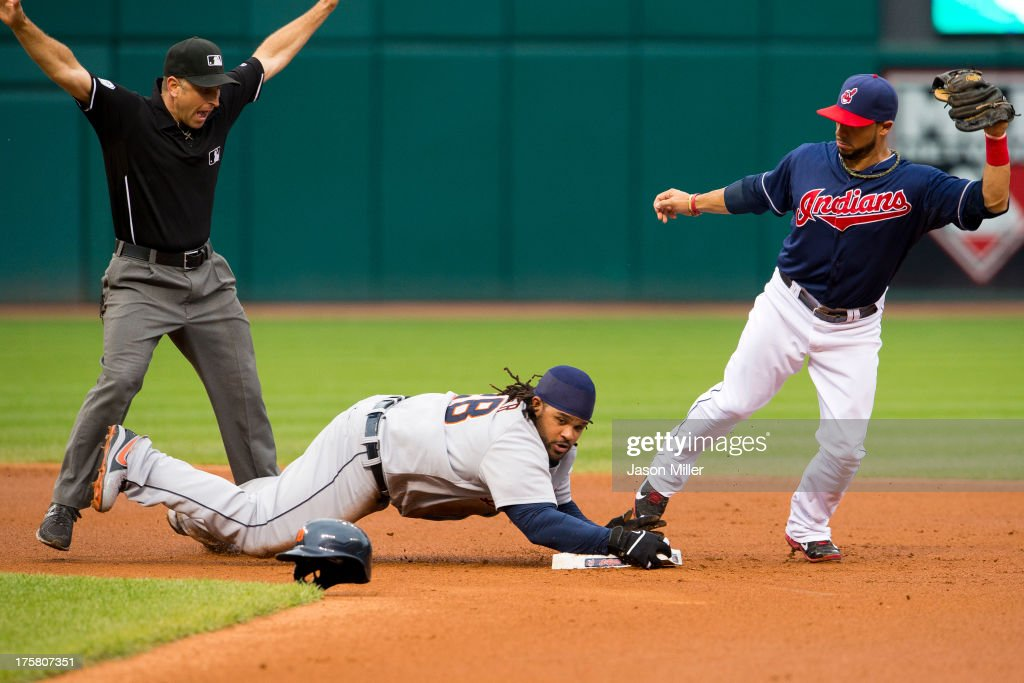 Second base umpire <a gi-track='captionPersonalityLinkClicked' href=/galleries/search?phrase=Phil+Cuzzi&family=editorial&specificpeople=260231 ng-click='$event.stopPropagation()'>Phil Cuzzi</a> #10 calls <a gi-track='captionPersonalityLinkClicked' href=/galleries/search?phrase=Prince+Fielder&family=editorial&specificpeople=209392 ng-click='$event.stopPropagation()'>Prince Fielder</a> #28 of the Detroit Tigers safe at second on a hit to right as second baseman <a gi-track='captionPersonalityLinkClicked' href=/galleries/search?phrase=Mike+Aviles&family=editorial&specificpeople=4944765 ng-click='$event.stopPropagation()'>Mike Aviles</a> #4 of the Cleveland Indians tries to make the play during the second inning at Progressive Field on August 8, 2013 in Cleveland, Ohio.