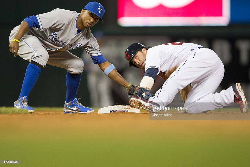 Second baseman <a gi-track='captionPersonalityLinkClicked' href=/galleries/search?phrase=Alcides+Escobar&family=editorial&specificpeople=4845889 ng-click='$event.stopPropagation()'>Alcides Escobar</a> #2 of the Kansas City Royals tries to put a tag on <a gi-track='captionPersonalityLinkClicked' href=/galleries/search?phrase=Jason+Kipnis&family=editorial&specificpeople=5330784 ng-click='$event.stopPropagation()'>Jason Kipnis</a> #22 of the Cleveland Indians after Kipnis stole second during the seventh inning at Progressive Field on June 19, 2013 in Cleveland, Ohio.