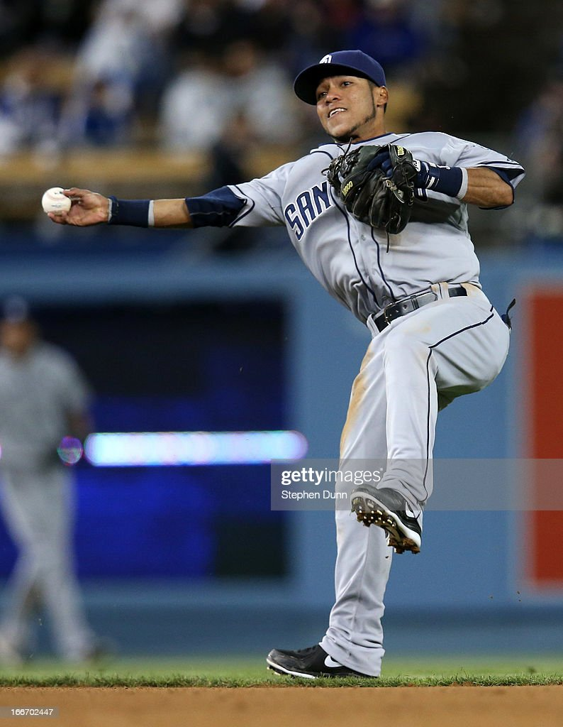 Second baseman <a gi-track='captionPersonalityLinkClicked' href=/galleries/search?phrase=Alexi+Amarista&family=editorial&specificpeople=6795464 ng-click='$event.stopPropagation()'>Alexi Amarista</a> of the San Diego Padres throws to first but can't get A.J. Ellis of the Los Angeles Dodgers on an infield single in the eighth inning at Dodger Stadium on April 15, 2013 in Los Angeles, California. All uniformed team members are wearing jersey number 42 in honor of Jackie Robinson Day.