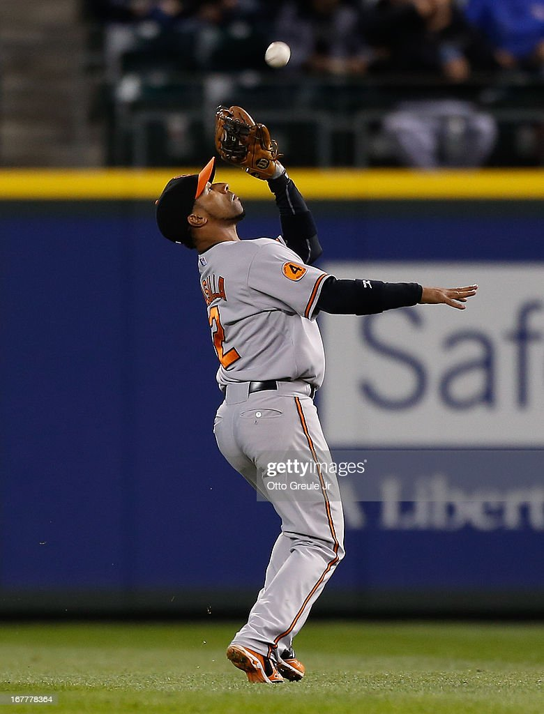 Second baseman <a gi-track='captionPersonalityLinkClicked' href=/galleries/search?phrase=Alexi+Casilla&family=editorial&specificpeople=4180372 ng-click='$event.stopPropagation()'>Alexi Casilla</a> #12 of the Baltimore Orioles catches a fly ball by Justin Smoak of the Seattle Mariners in the fourth inning at Safeco Field on April 29, 2013 in Seattle, Washington.