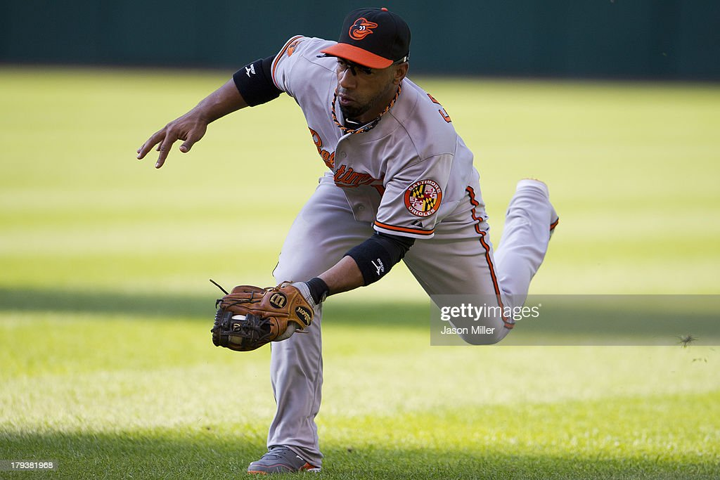 Second baseman <a gi-track='captionPersonalityLinkClicked' href=/galleries/search?phrase=Alexi+Casilla&family=editorial&specificpeople=4180372 ng-click='$event.stopPropagation()'>Alexi Casilla</a> #12 of the Baltimore Orioles fields a ground ball hit by Carlos Santana #41 of the Cleveland Indians for an out to end the fourth inning at Progressive Field on September 2, 2013 in Cleveland, Ohio.