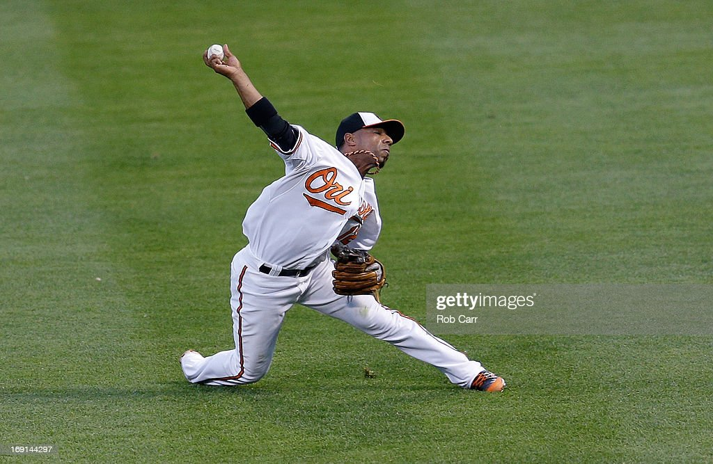 Second baseman Alexi Casilla of the Baltimore Orioles throws to first base to get out Curtis Granderson of the New York Yankees for the third out of...
