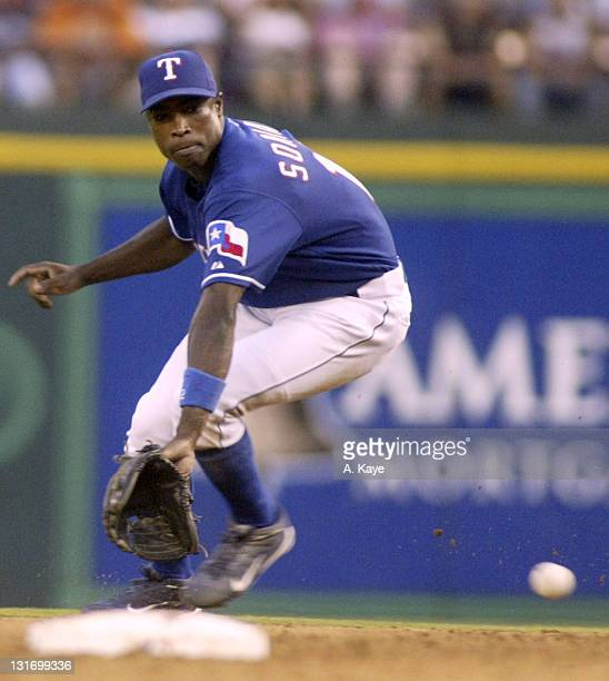 Second baseman Alfonso Soriano of the Texas Rangers draws a bead on a Bernie Williams ground ball Unfortunately the ball went through his legs for a...