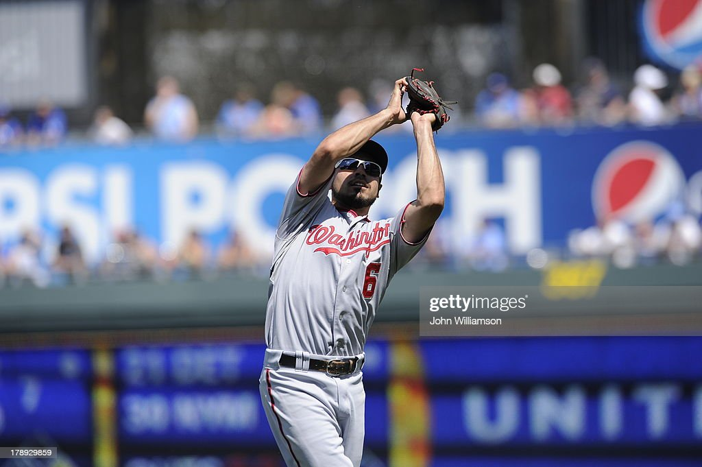 Second baseman <a gi-track='captionPersonalityLinkClicked' href=/galleries/search?phrase=Anthony+Rendon&family=editorial&specificpeople=7539238 ng-click='$event.stopPropagation()'>Anthony Rendon</a> #6 of the Washington Nationals fields his position as he catches a fly ball in the game against the Kansas City Royals on August 25, 2013 at Kauffman Stadium in Kansas City, Missouri. The Kansas City Royals defeated the Washington Nationals 6-4.