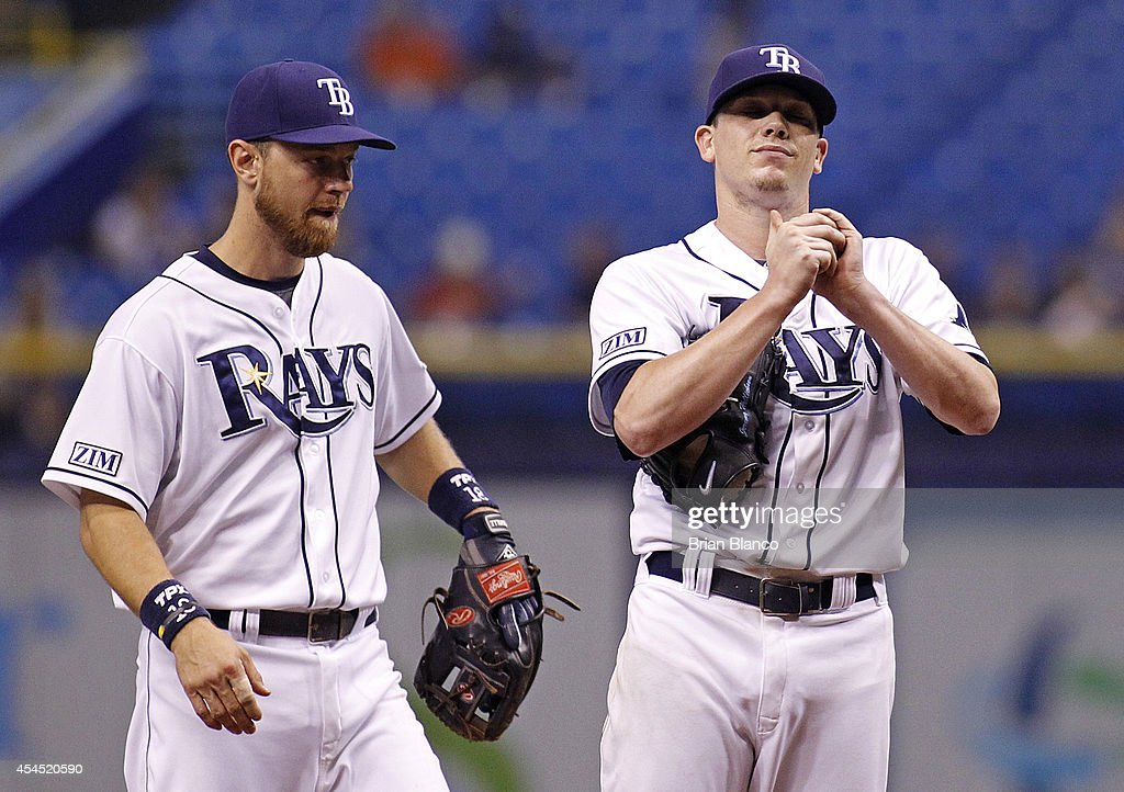 Second baseman <a gi-track='captionPersonalityLinkClicked' href=/galleries/search?phrase=Ben+Zobrist&family=editorial&specificpeople=2120037 ng-click='$event.stopPropagation()'>Ben Zobrist</a> #18 of the Tampa Bay Rays comes out to the mound to speak with pitcher <a gi-track='captionPersonalityLinkClicked' href=/galleries/search?phrase=Jeremy+Hellickson&family=editorial&specificpeople=2364859 ng-click='$event.stopPropagation()'>Jeremy Hellickson</a> #58 after Hellickson walked Edwin Encarnacion of the Toronto Blue Jays to load the bases during the third inning of a game on September 2, 2014 at Tropicana Field in St. Petersburg, Florida.