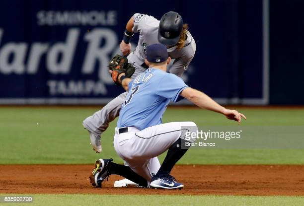 Second baseman Brad Miller of the Tampa Bay Rays catches Ben Gamel of the Seattle Mariners attempting to steal second base after Carlos Ruiz struck...