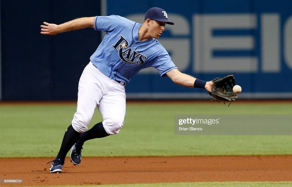Second baseman Brad Miller #13 of the Tampa Bay Rays fields the ground out by Jean Segura of the Seattle Mariners during the first inning of a game on August 20, 2017 at Tropicana Field in St. Petersburg, Florida.