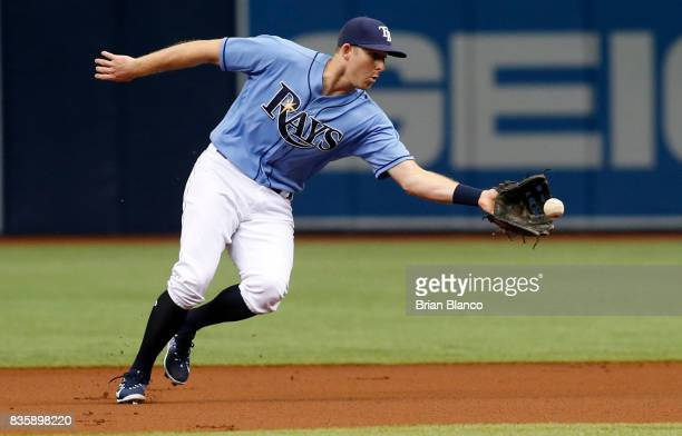 Second baseman Brad Miller of the Tampa Bay Rays fields the ground out by Jean Segura of the Seattle Mariners during the first inning of a game on...