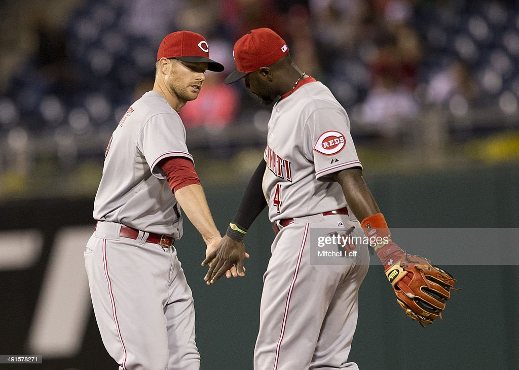 Second baseman Brandon Phillips #4 and shortstop Zack Cozart #2 of the Cincinnati Reds react after defeating the Philadelphia Phillies on May 16, 2014 at Citizens Bank Park in Philadelphia, Pennsylvania.