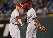 Second baseman Brandon Phillips and shortstop Zack Cozart of the Cincinnati Reds react after defeating the Philadelphia Phillies on May 16 2014 at...