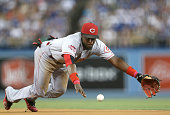 Second baseman Brandon Phillips of the Cincinnati Reds dives but can't reach a single hit by Adrian Gonzalez of the Los Angeles Dodgers in the third...