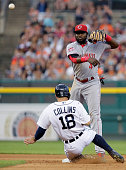 Second baseman Brandon Phillips of the Cincinnati Reds turns the ball after getting a force out on Tyler Collins of the Detroit Tigers during the...