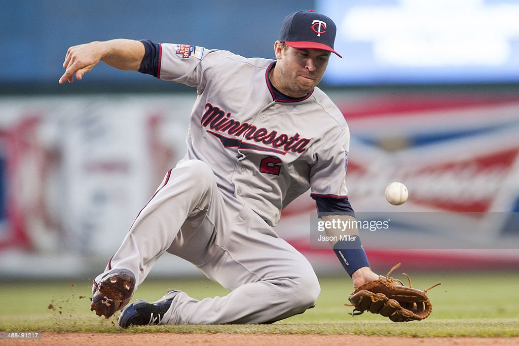 Second baseman <a gi-track='captionPersonalityLinkClicked' href=/galleries/search?phrase=Brian+Dozier&family=editorial&specificpeople=7553002 ng-click='$event.stopPropagation()'>Brian Dozier</a> #2 of the Minnesota Twins bobbles a ground ball hit by David Murphy (not pictured) of the Cleveland Indians during the third inning at Progressive Field on May 6, 2014 in Cleveland, Ohio.