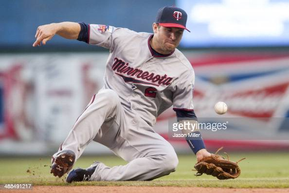 Second baseman Brian Dozier of the Minnesota Twins bobbles a ground ball hit by David Murphy of the Cleveland Indians during the third inning at...