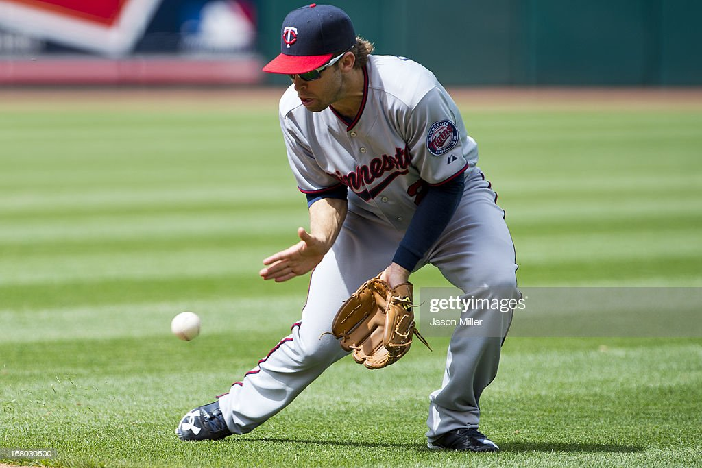 Second baseman <a gi-track='captionPersonalityLinkClicked' href=/galleries/search?phrase=Brian+Dozier&family=editorial&specificpeople=7553002 ng-click='$event.stopPropagation()'>Brian Dozier</a> #2 of the Minnesota Twins fields a ground ball hit by Carlos Santana #41 of the Cleveland Indians to end the fifth inning at Progressive Field on May 4, 2013 in Cleveland, Ohio.