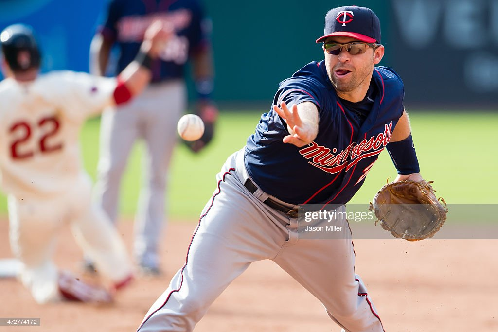 Second baseman <a gi-track='captionPersonalityLinkClicked' href=/galleries/search?phrase=Brian+Dozier&family=editorial&specificpeople=7553002 ng-click='$event.stopPropagation()'>Brian Dozier</a> #2 of the Minnesota Twins throws out <a gi-track='captionPersonalityLinkClicked' href=/galleries/search?phrase=Carlos+Santana+-+Baseball+Player&family=editorial&specificpeople=11497843 ng-click='$event.stopPropagation()'>Carlos Santana</a> #41 of the Cleveland Indians at first during the sixth inning at Progressive Field on May 9, 2015 in Cleveland, Ohio.