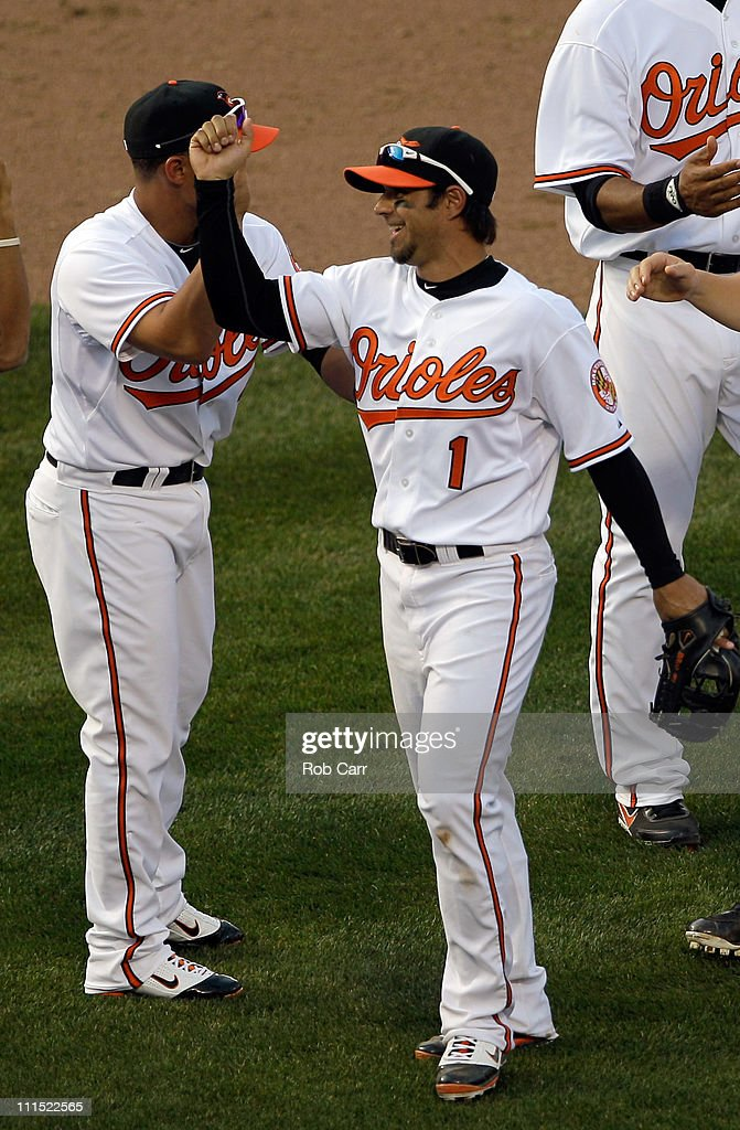 Second baseman Brian Roberts #1 of the Baltimore Orioles celebrates with teammates after the Orioles defeated the Detroit Tigers 5-1 during opening day at Oriole Park at Camden Yards on April 4, 2011 in Baltimore, Maryland.