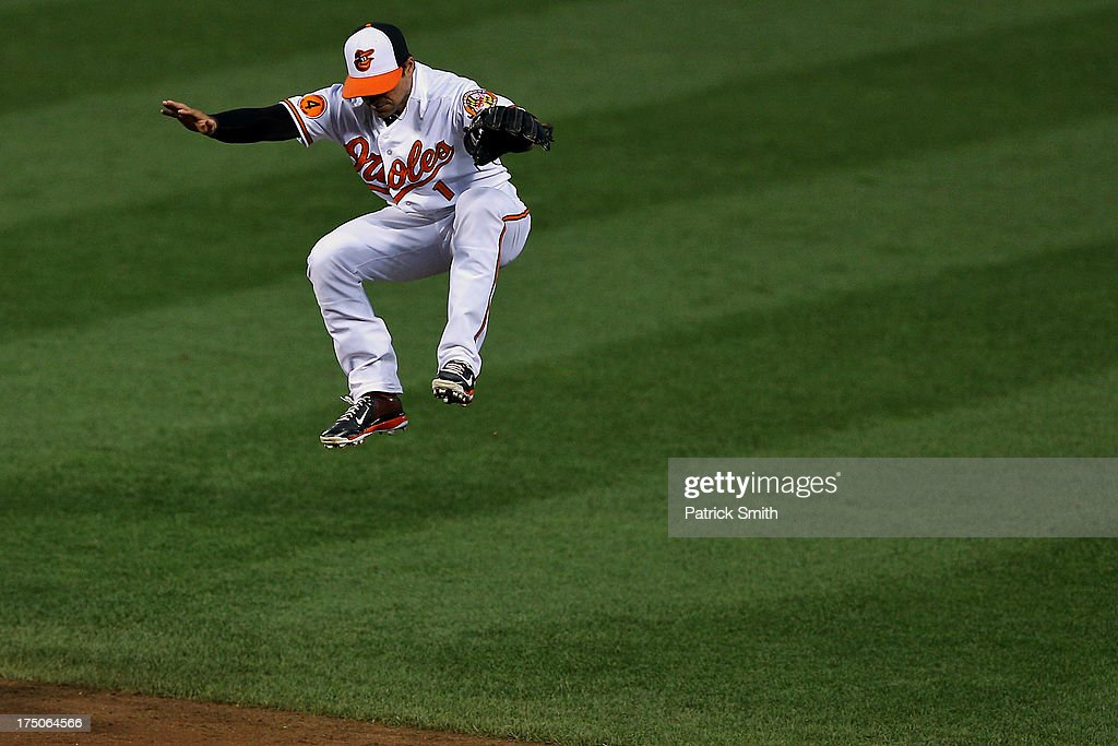 Second baseman Brian Roberts #1 of the Baltimore Orioles jumps into the air in an attempt to catch a hit by the Houston Astros in the fourth inning at Oriole Park at Camden Yards on July 30, 2013 in Baltimore, Maryland. The Baltimore Orioles won, 4-3.