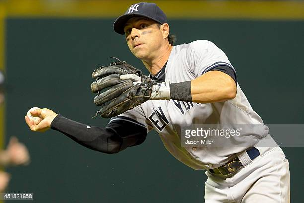 Second baseman Brian Roberts of the New York Yankees throws out Jason Kipnis of the Cleveland Indians at first base during the sixth inning at...