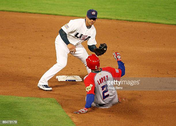 Second baseman Brian Roberts of United States prepares to tag out Felipe Lopez of Puerto Rico on a faile steal attempt during day 4 of round 2 of the...