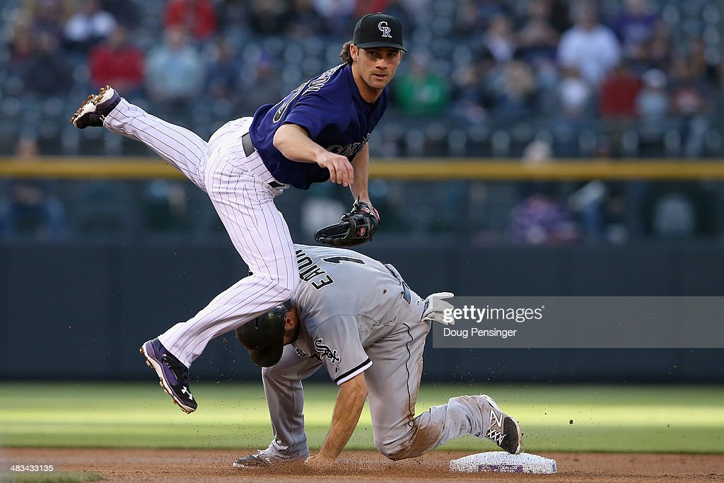 Second baseman Charlie Culberson #23 of the Colorado Rockies avoids the slide of <a gi-track='captionPersonalityLinkClicked' href=/galleries/search?phrase=Adam+Eaton&family=editorial&specificpeople=210898 ng-click='$event.stopPropagation()'>Adam Eaton</a> #1 of the Chicago White Sox and turns a double play on Marcus Semien #5 of the Chicago White Sox in the first inning during interleague play at Coors Field on April 8, 2014 in Denver, Colorado.