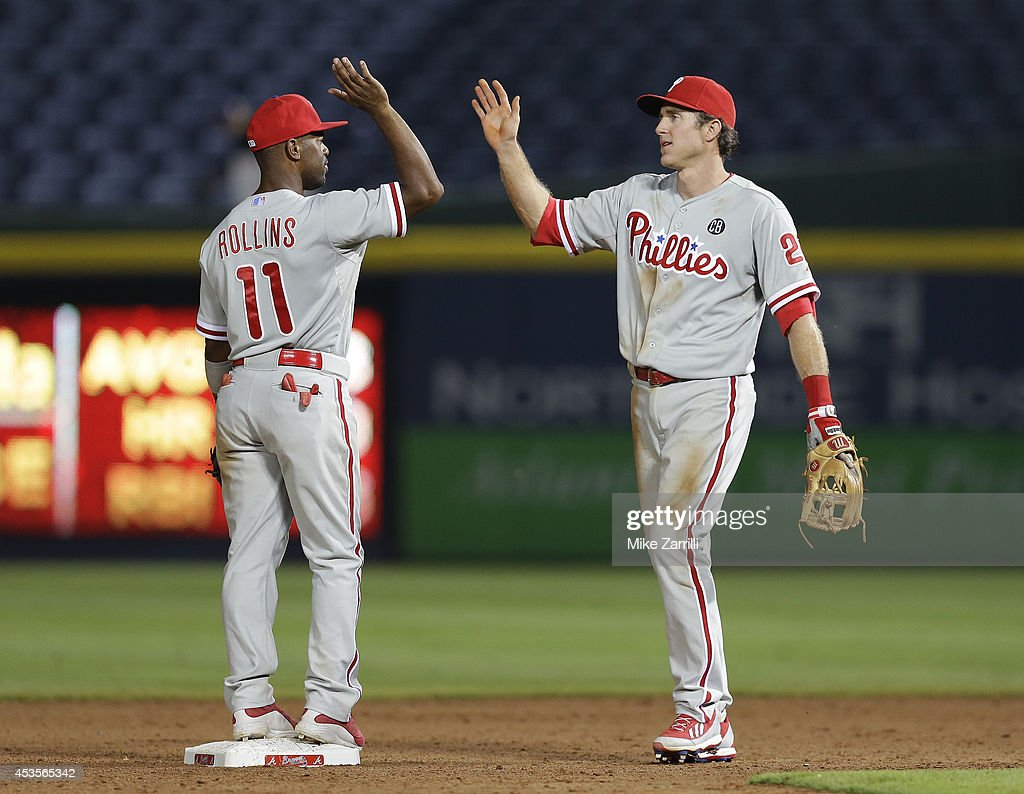 Second baseman Chase Utley #26 and shortstop Jimmy Rollins #11 of the Philadelphia Phillies celebrate after the game against the Atlanta Braves at Turner Field on June 16, 2014 in Atlanta, Georgia.