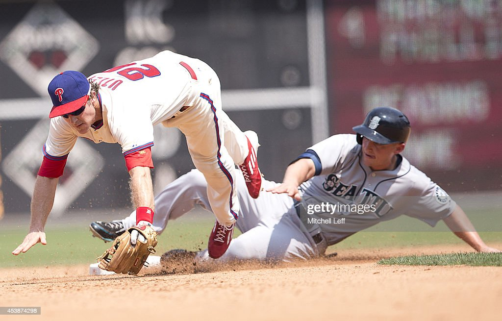 Second baseman <a gi-track='captionPersonalityLinkClicked' href=/galleries/search?phrase=Chase+Utley&family=editorial&specificpeople=161391 ng-click='$event.stopPropagation()'>Chase Utley</a> #26 of the Philadelphia Phillies cannot handle the throw made to him by third baseman Andres Blanco #4 (NOT PICTURED) in the top of the fourth inning against the Seattle Mariners on August 20, 2014 at Citizens Bank Park in Philadelphia, Pennsylvania.