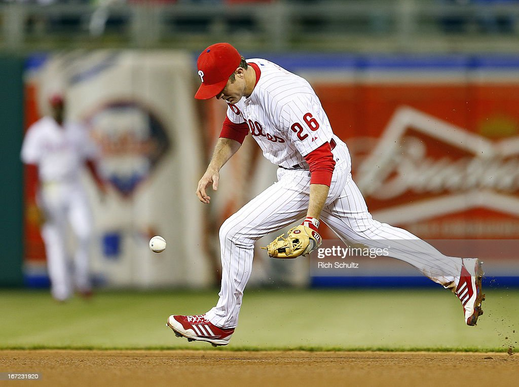 Second baseman <a gi-track='captionPersonalityLinkClicked' href=/galleries/search?phrase=Chase+Utley&family=editorial&specificpeople=161391 ng-click='$event.stopPropagation()'>Chase Utley</a> #26 of the Philadelphia Phillies can't handle a ground ball hit by Pedro Alvarez #24 of the Pittsburgh Pirates in the seventh inning of a MLB baseball game on April 22, 2013 at Citizens Bank Park in Philadelphia, Pennsylvania. The Phillies defeated the Pirates 3-2.