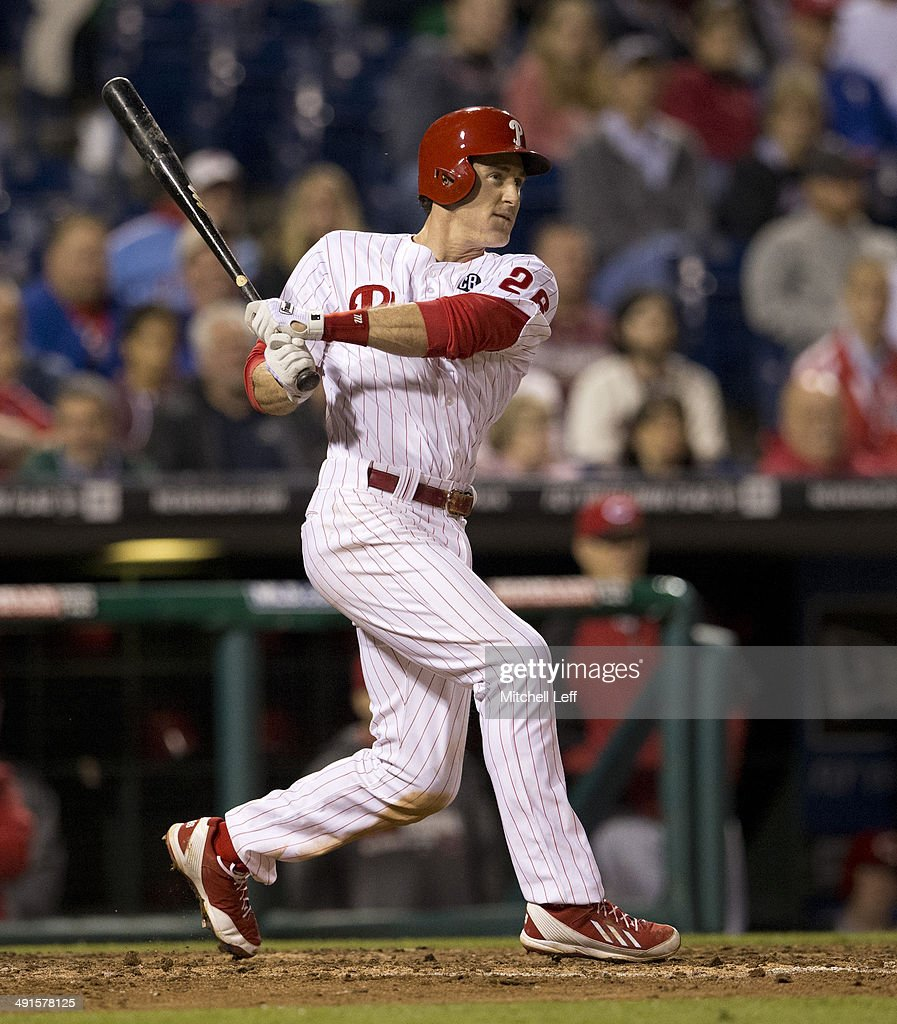 Second baseman <a gi-track='captionPersonalityLinkClicked' href=/galleries/search?phrase=Chase+Utley&family=editorial&specificpeople=161391 ng-click='$event.stopPropagation()'>Chase Utley</a> #26 of the Philadelphia Phillies hits a single in the bottom of the eighth inning against the Cincinnati Reds on May 16, 2014 at Citizens Bank Park in Philadelphia, Pennsylvania.