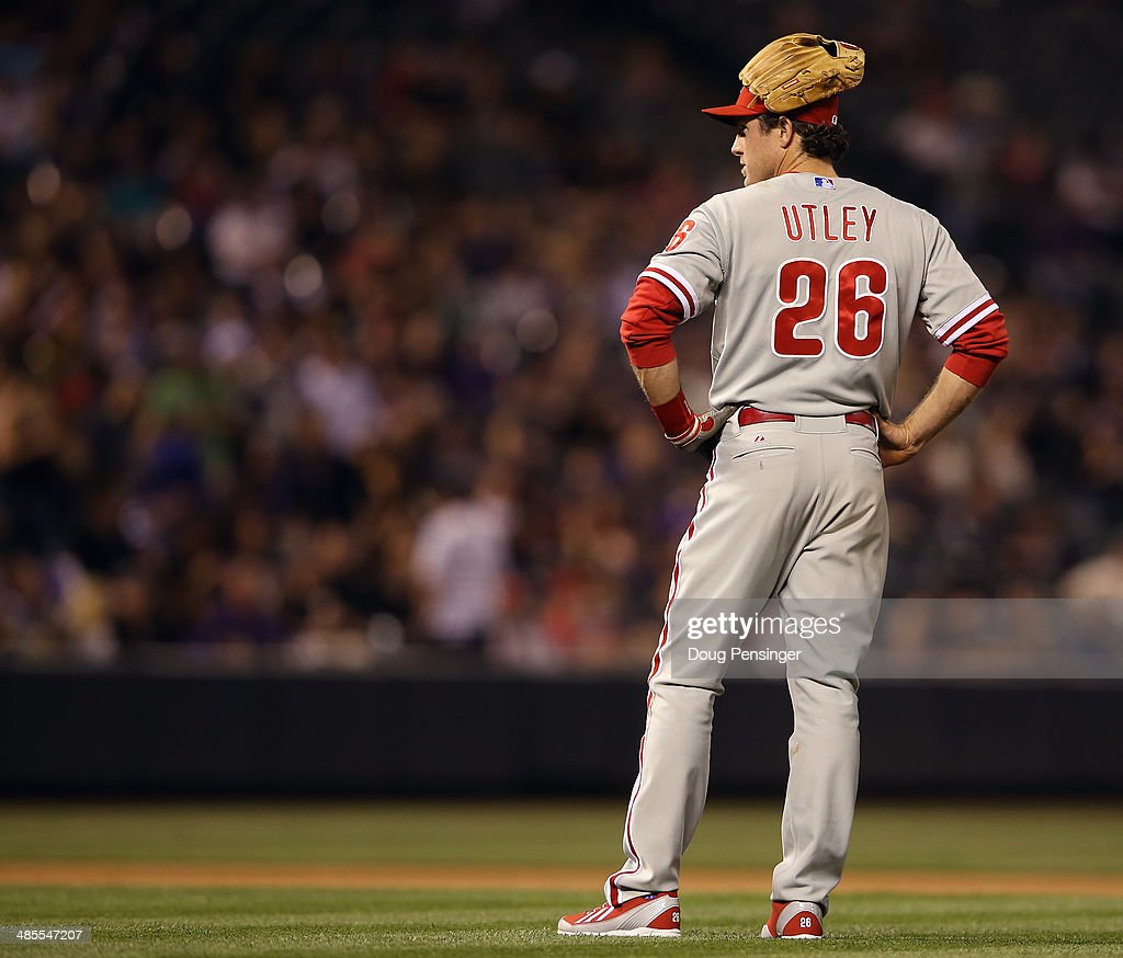 Second baseman <a gi-track='captionPersonalityLinkClicked' href=/galleries/search?phrase=Chase+Utley&family=editorial&specificpeople=161391 ng-click='$event.stopPropagation()'>Chase Utley</a> #26 of the Philadelphia Phillies wears his glove on his head as he awaits a pitching change in the seventh inning at Coors Field on April 18, 2014 in Denver, Colorado.