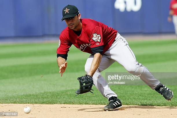 Second baseman Chris Burke of the Houston Astros fields a ball against the New York Mets on July 23 2006 at Shea Stadium in the Flushing neighborhood...