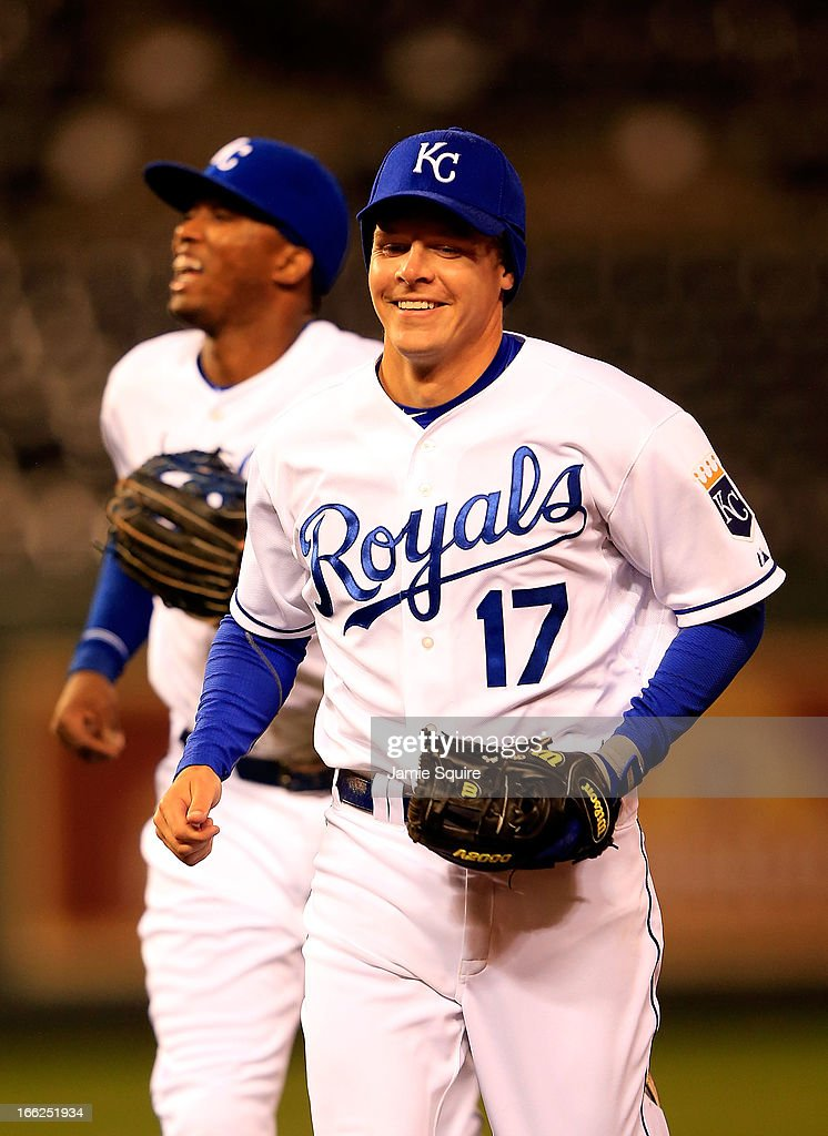 Second baseman <a gi-track='captionPersonalityLinkClicked' href=/galleries/search?phrase=Chris+Getz&family=editorial&specificpeople=4936717 ng-click='$event.stopPropagation()'>Chris Getz</a> #17 and Kansas City Royals shortstop <a gi-track='captionPersonalityLinkClicked' href=/galleries/search?phrase=Alcides+Escobar&family=editorial&specificpeople=4845889 ng-click='$event.stopPropagation()'>Alcides Escobar</a> #2 smile as they leave the field during the game against the Minnesota Twins at Kauffman Stadium on April 10, 2013 in Kansas City, Missouri.