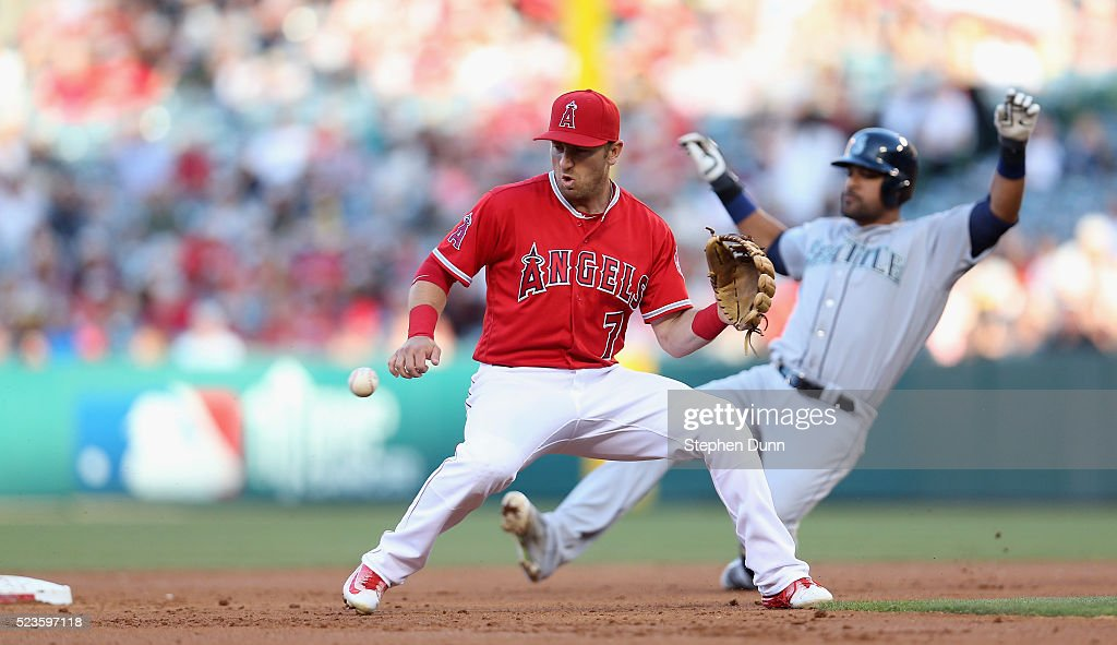 Second baseman Cliff Pennington of the Los Angeles Angels of Anaheim takes the throw as Franklin Gutierrez of the Seattle Mariners slides into second...