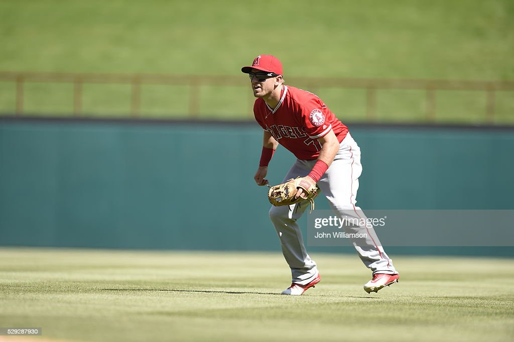 Second baseman Cliff Pennington of the Los Angeles Angels of Anaheim looks to home plate as the pitch is delivered in the game against the Texas...