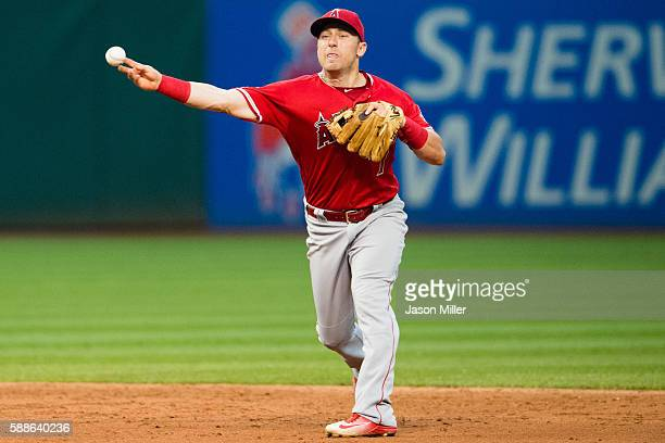 Second baseman Cliff Pennington of the Los Angeles Angels of Anaheim throws out Francisco Lindor of the Cleveland Indians at first to end the third...