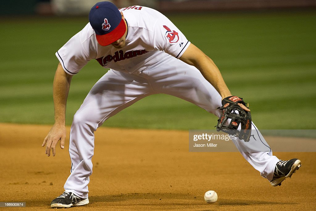 Second baseman Cord Phelps #46 of the Cleveland Indians can't handle a ground ball off the bat of Shane Victorino (not pictured) of the Boston Red Sox in the seventh inning at Progressive Field on April 18, 2013 in Cleveland, Ohio.