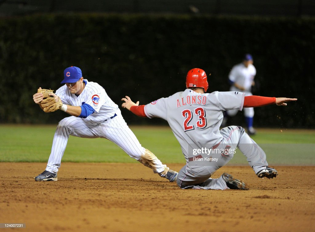 Second baseman D J LeMahieu of the Chicago Cubs forces out Yonder Alonso of the Cincinnati Reds at second base after Ramon Hernandez hit a line drive...