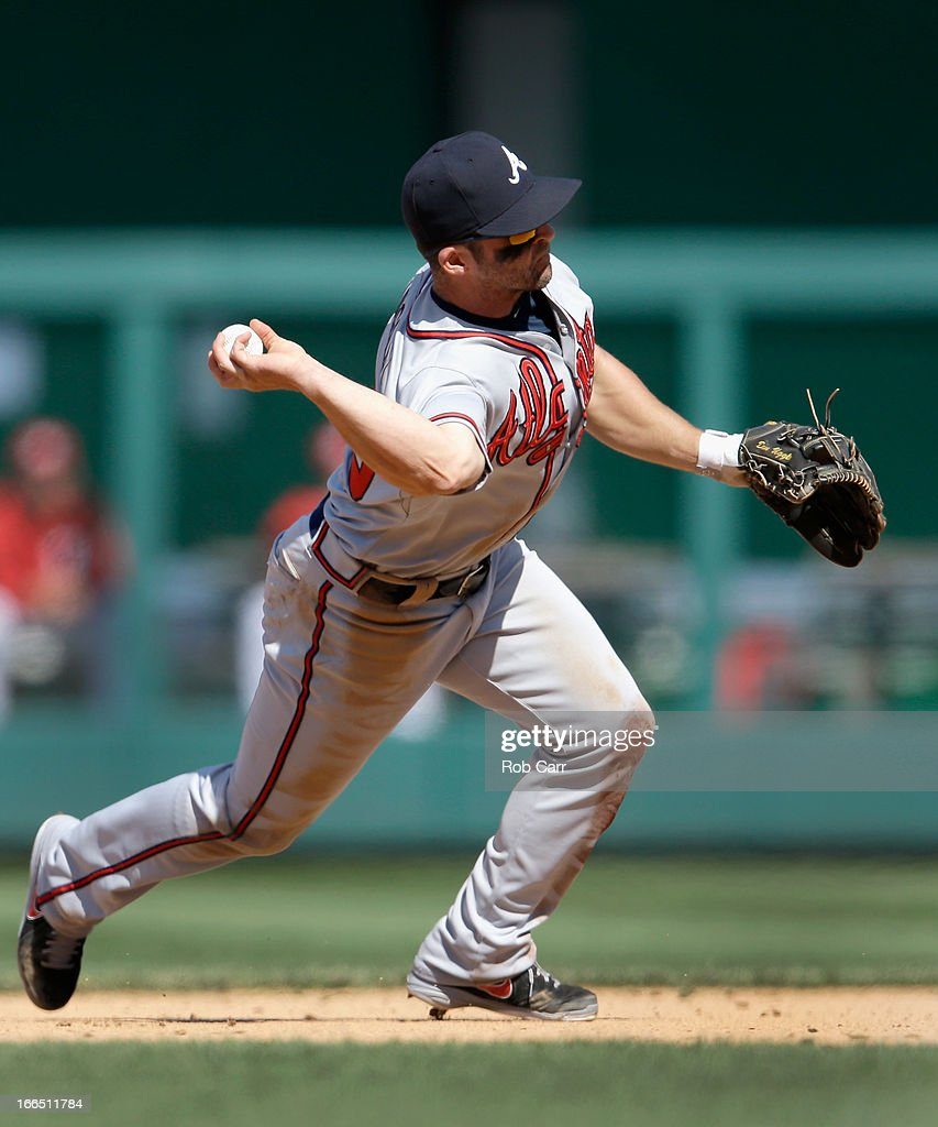 Second baseman <a gi-track='captionPersonalityLinkClicked' href=/galleries/search?phrase=Dan+Uggla&family=editorial&specificpeople=542208 ng-click='$event.stopPropagation()'>Dan Uggla</a> #26 of the Atlanta Braves throws to first base for the third out of the eighth inning during the Braves 3-1 win over the Washington Nationals at Nationals Park on April 13, 2013 in Washington, DC.